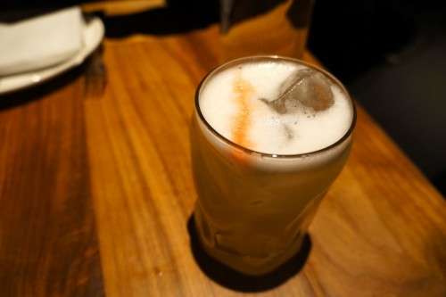 Sombra Sour - Sombra mezcal, hoja santa, fresh lime, egg white, Peychaud's