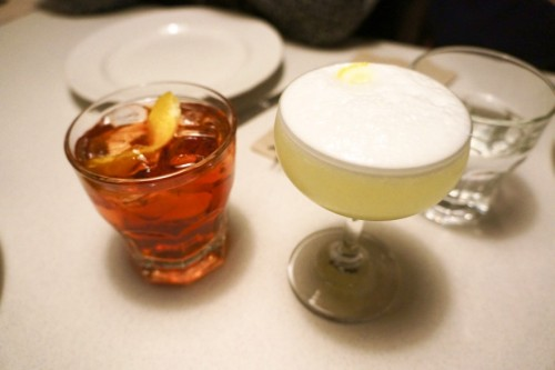 A classic negroni and gin fizz